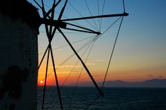 Windmills at Sunset - 3. Closeup of details of a windmill at Mykonos, Greece as the sun sets into the horizon and the water Stock Images