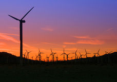 Windmills at sunset. Windmills in a wind farm at sunset Stock Image