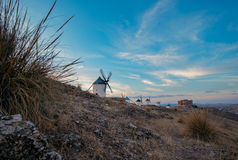 Windmills at the sunset in Consuegra town in Spain Royalty Free Stock Images