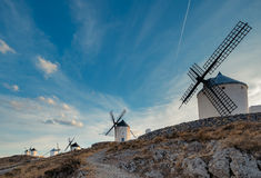 Windmills at the sunset in Consuegra town in Spain Stock Image