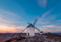 Windmills at the sunset in Consuegra town in Spain Stock Images