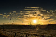 Windmills at sunset Stock Photo