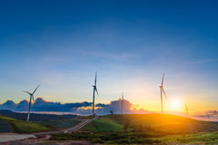 Windmills in sunset time sky. Stock Image