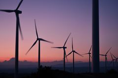 Windmills during Sunset View Stock Photos