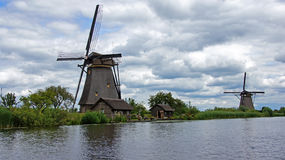 Windmills under dutch sky at Kinderdijk Royalty Free Stock Photos