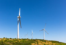 Windmills in the valley Royalty Free Stock Image