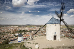 Windmills and a view over Consuegra town, province of Toledo, Castilla-La Mancha, Spain. White windmills and a view over Consuegra town, province of Toledo Royalty Free Stock Photo