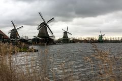 Windmills in the village Zaanse Schans on a cloudy autumn day, The Netherlands royalty free stock photography