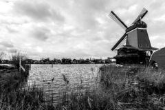 Windmills in the village Zaanse Schans on a cloudy autumn day, The Netherlands royalty free stock images