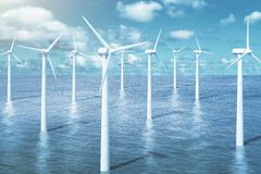 Windmills in the water with sky background Stock Image