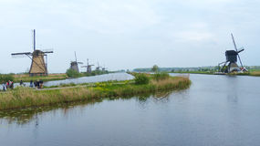 Windmills and waters of Kinderdijk Royalty Free Stock Images