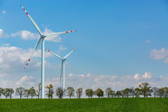 Windmills on the wheat field Royalty Free Stock Images