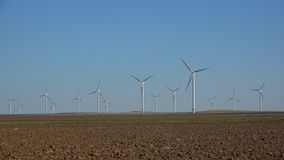 Windmills, Wind Turbines, Agriculture Wheat Field Generator Power, Electricity royalty free stock photo