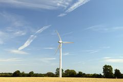 Windmills. Windmill on the field of grain royalty free stock images
