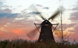 Windmills at windy sunset Royalty Free Stock Photos