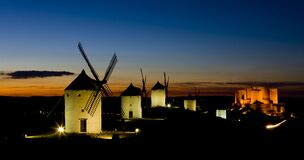 Windmills With Castle At Night, Consuegra, Castile-La Mancha, Sp Royalty Free Stock Photography