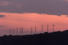 Windmills working at sunset Stock Photography