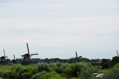 Windmills of the World Heritage Kinderdijk, Netherlands. Travelling to Holland visiting the windmill park of the UNESCO World Heritage Kinderdijk stock photos