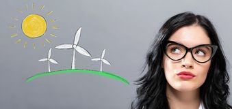 Windmills with young businesswoman. In a thoughtful face Stock Photos