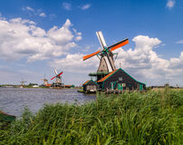Windmills of Zaanse Schans, Holland. The famous windmills of the 'Zaanse Schans' to the North of Amsterdam on a beautiful sunny day Royalty Free Stock Photos