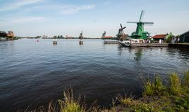 Windmills in Zaanse Schans, Netherlands. Famous Windmills by the river in Zaanse Schans, Netherlands. Some ducks in the river too royalty free stock photography