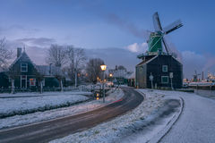 Windmills in Zaanse Schans. Traditional Dutch landscape early in the morning Stock Photo