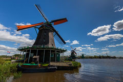Windmills at Zaanse Schans. Typical Windmills at Zaanse Schans in Netherlands with great blue sky stock photography