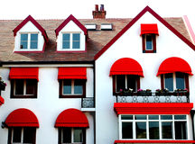 Window. House under the sun particularly eye-catching red awning Stock Photo