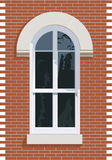 Window. Arched top window with stone and brick Royalty Free Stock Photos