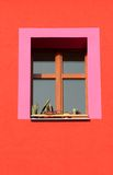 Window. Pink framed window on red house Royalty Free Stock Photography