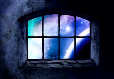 Through the Window. A window set into a grungey wall, looking out to the galaxy full of stars Royalty Free Stock Images