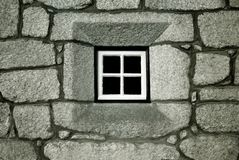 Window. A stone wall with a window at the center of the composition stock photos