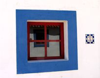 Window. Of a traditional rural house of the south of Portugal. The colors are typical, with white walls (to minimize the heat of the sun) and blue frames. Also Royalty Free Stock Photo