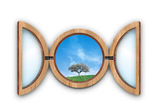 Window. Circular window's illustration with a blu sky and one tree hill Royalty Free Stock Photos