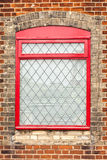 Window. A red window frame in a red brick wall Royalty Free Stock Images