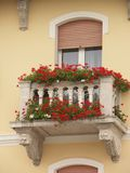 Window #2. Small nice balcony with flowers Stock Image