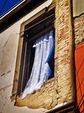 Window. A courtain in an old window at a ruined wall Stock Photography