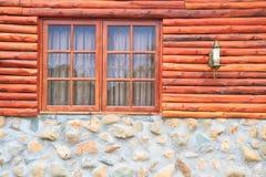 Window. Wood and rock wall stock image