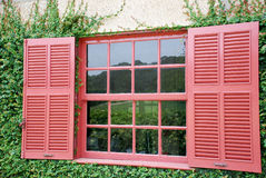 Window. A red window and the reflex in Portuguese farm house Royalty Free Stock Image