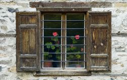 Window. With flower-pots in Bulgarian village Royalty Free Stock Images