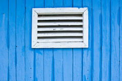 Window. Of a blue painted wooden bungalow Stock Photography
