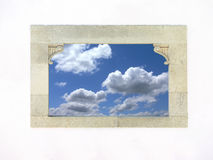 Window. Ancient stone window with a blue sky and clouds Stock Photos