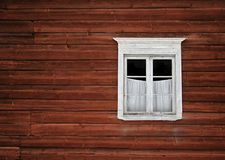 Window. A small window of an old red house Stock Images