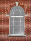 Window. One arched window on red brick building Royalty Free Stock Photography