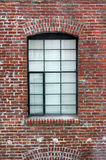 Window. Black trimmed window in a red brick building Stock Photos