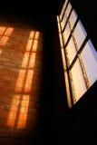 Window. With sunlight illuminating brick wall royalty free stock photography