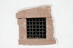 Window. Grated window on old house Royalty Free Stock Image