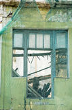 Window of abandoned building. Broken window of old abandoned building without glass stock illustration