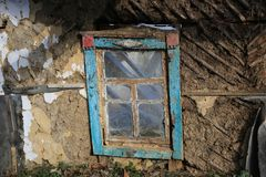 Window of abandoned house. Window and mud wall of abandoned clay house Royalty Free Stock Images
