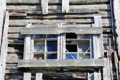 Window of abandoned  Lofotens house Stock Photo